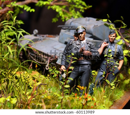 Wehrmacht soldiers on a battlefield WW2, plastic kit 1 : 48 scale homemade work - stock photo