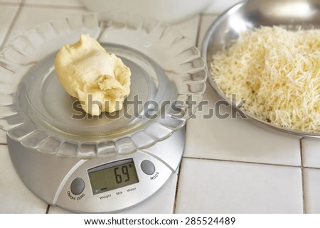 Weighing bread dough using electronic scales - stock photo