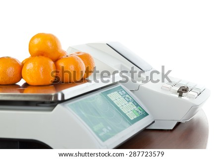 Weighing of fruits on electronic scales, isolated on white background.  - stock photo