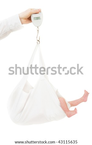 weighing the baby - stock photo