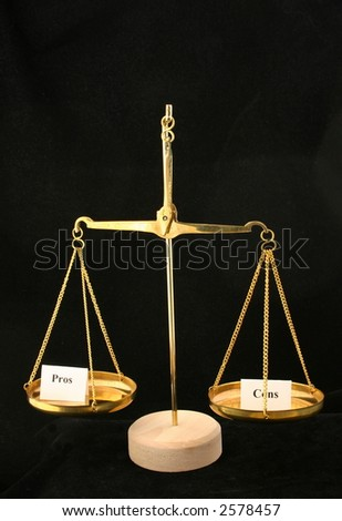 Weighing the pros and cons - stock photo