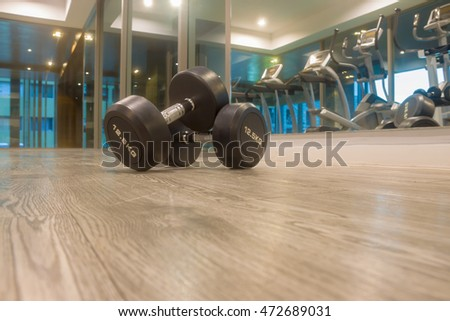 weight body building with Sports dumbbles,Dumbbells in the fitness room.