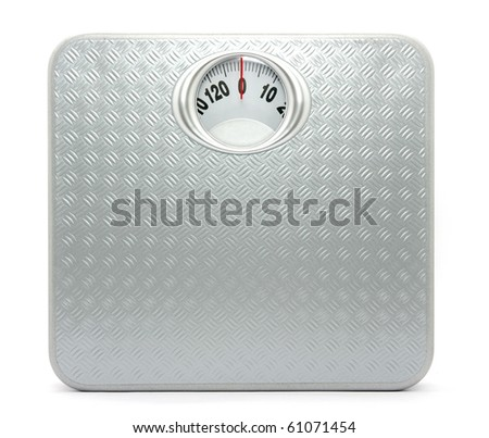 Weight control by floor scale - stock photo
