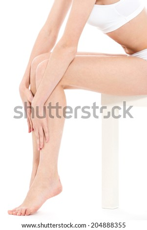 Weight, diet. Cute, attractive girl on a white background - stock photo