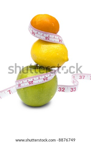 Weight loss and healthy dieting concept. Apple, lemon and mandarin with measure tape. Isolated over white. - stock photo