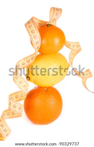 Weight loss and healthy dieting concept. Orange, lemon and mandarin with measure tape. Isolated over white.. - stock photo