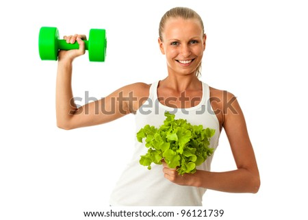 Weight loss concept - tanned woman lifting dumbbell and green salad isolated on white background - stock photo