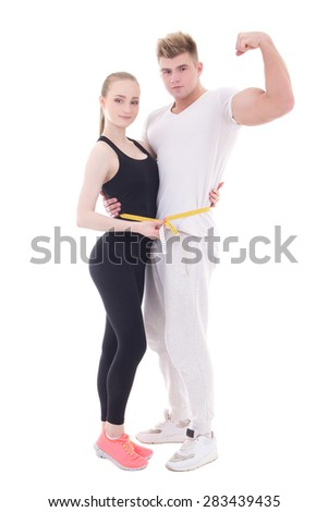 weight loss concept - young muscular man and slim woman with measure tape isolated on white background - stock photo
