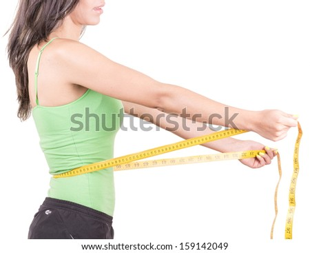 weight loss  hispanic woman smiling with measuring tape - stock photo