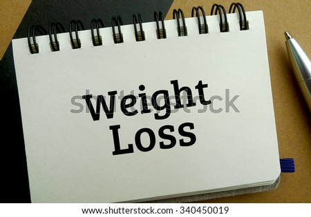 Weight loss memo written on a notebook with pen