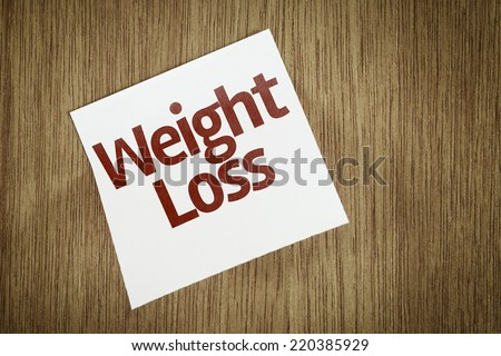 Weight Loss on Paper Note with texture background - stock photo