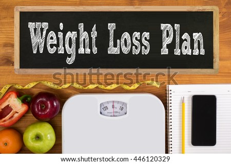 weight loss plan Fitness and weight loss concept, dumbbells, white scale, fruit and tape measure on a wooden table, top view, free copy space, phone - stock photo