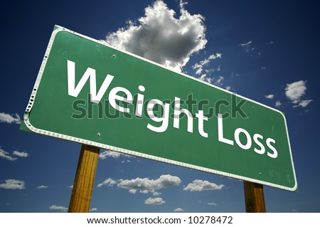 Weight Loss Road Sign with dramatic blue sky and clouds.