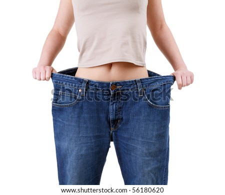 weight loss woman in too great jeans trousers - stock photo