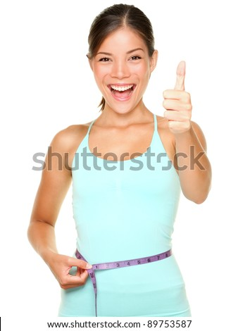 weight loss woman smiling happy excited standing with measuring tape giving thumbs up success hand sign isolated on white background. Asian female fitness model.