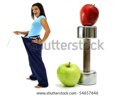 weight loss workout apples brunette in jeans - stock photo