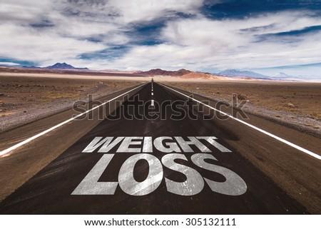 Weight Loss written on desert road - stock photo