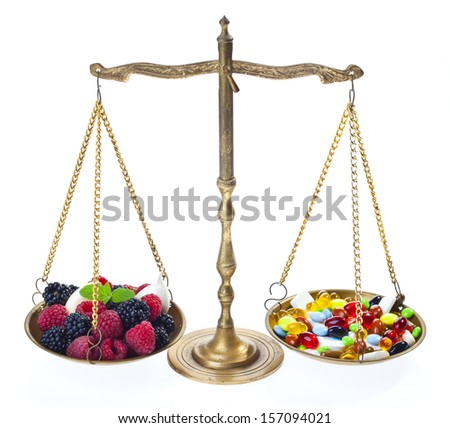 Weight of fruits and medicines - isolated white background - stock photo