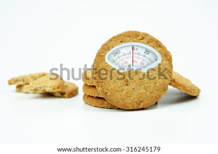 Weight scale made of grain cookies isolated on white background - stock photo