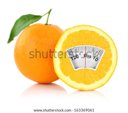 Weight scale on an orange, diet concept  - stock photo