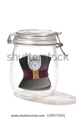 Weight Scales in a jar. - stock photo