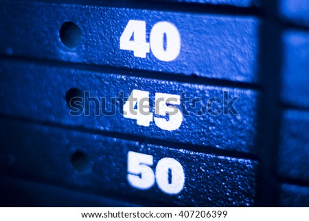 Weight training machine in fitness gym for weight training, bodybuilding and sports strength training. - stock photo