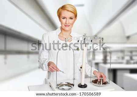 Weighting the component in lab, active substance, research - stock photo