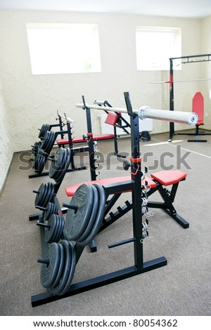 Weights and stationary equipment at a gym. - stock photo