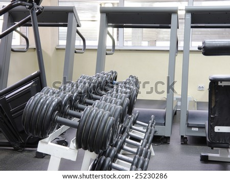 Weights rack with treadmills row on background indoor photo