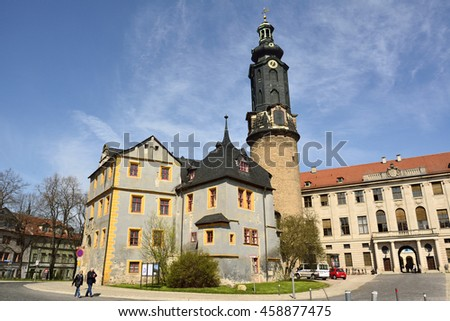 WEIMAR, GERMANY - APRIL 12, 2016. View of Stadtschloss Weimar, with tower and the oldest part Bastille on the left, with cars and people.
