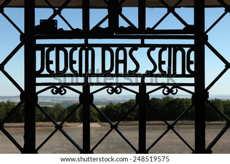 WEIMAR, GERMANY - JUNE 21, 2013: Notorious Nazi motto Jedem das Seine (To Each His Own) seen on the main gate of the Buchenwald concentration camp near Weimar, Germany. - stock photo