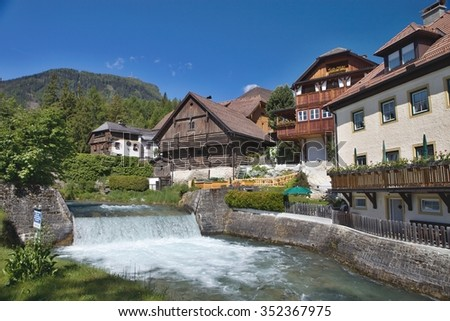 weir and traditional wooden houses in Mauterndorf, Austria
