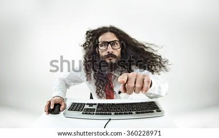 Weird computer geek with keyboard - stock photo