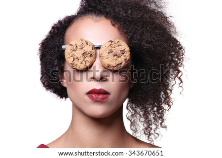 Weird, crazy. Woman with glasses made out of cookies - stock photo