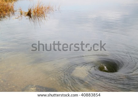 weird deep  whirlpool on a river - stock photo