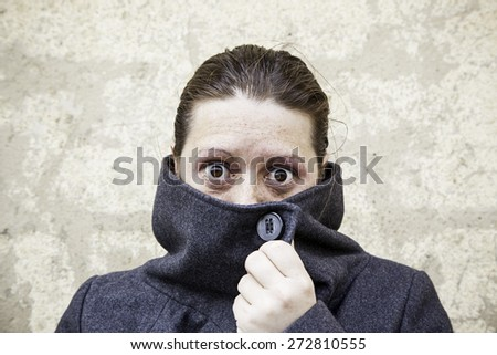 Weird girl covered with scary look - stock photo