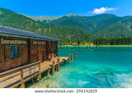 "WEISSENSEE LAKE, AUSTRIA - JUL 7, 2015: ""old wooden boat house on shore of Weissensee lake which is the highest situated Carinthian bathing lake."