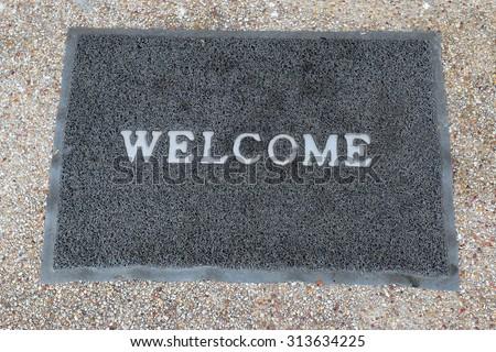 welcome carpet on floor - stock photo