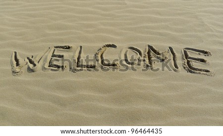 Welcome concept with sign on the sea shore.