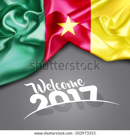 Welcome 2017 creative typography Cameroon Flag on Texture background