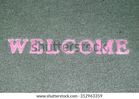 Welcome doormat - stock photo