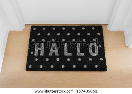 Welcome home black mat. Hallo - stock photo