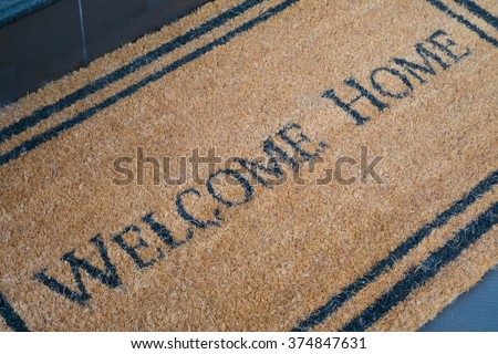 welcome home carpet - stock photo