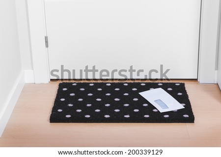 Welcome home doormat with envelope - stock photo