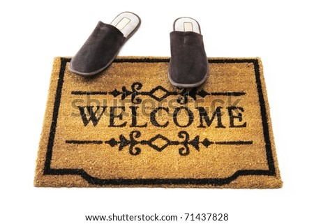 Welcome mat and slippers - stock photo