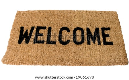 Welcome Mat in large clear Bold black letters - stock photo