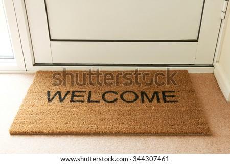 Welcome Mat Inside Doorway Of Home - stock photo