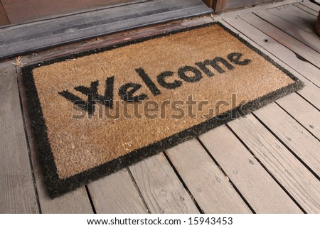 Welcome mat on a porch - stock photo