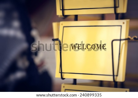 Welcome Sign - image of yellow sign with word welcome - stock photo