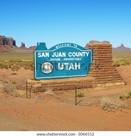 Welcome sign in desert for San Juan County in Monument Valley, Utah.
